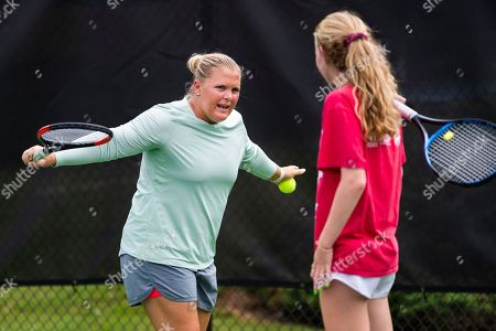 Stock Image of Retired tennis player Melanie Oudin, 27, works with young players at Windward Lake Club, in Alpharetta, Ga. In 2009, Oudin pulled off four upsets at the U.S. Open, including against Maria Sharapova, to become the youngest quarterfinalist at Flushing Meadows since Serena Williams in 1999