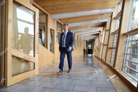 Scottish Parliament First Minister's Questions - Keith Brown, Cabinet Secretary for Economy, Jobs and Fair Work, and Depute Leader of the Scottish National Party (SNP), makes his way to the Debating Chamber.
