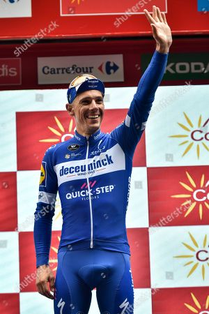 Deceunink -Quick's Team Philippe Gilbert of Belgium celebrates on the podium after winning the stage during the 12th stage between Circuito de Navarra- Los Arcos and Bilbao, 171,4 kilometers (106,50miles), of the Spanish Vuelta cycling race that finishes in Bilbao, northern Spain, Thursday, Sept.5, 2019