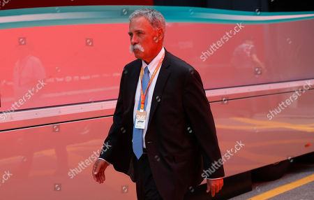 Stock Photo of Formula One chairman Chase Carey walks in the paddock, at the Monza racetrack, in Monza, Italy, . The Formula one GP will be held on Sunday