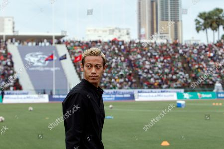 Cambodia's manager Keisuke Honda looks on before the World Cup Group C qualifying soccer match between Cambodia and Hong Kong in Phnom Penh, Cambodia