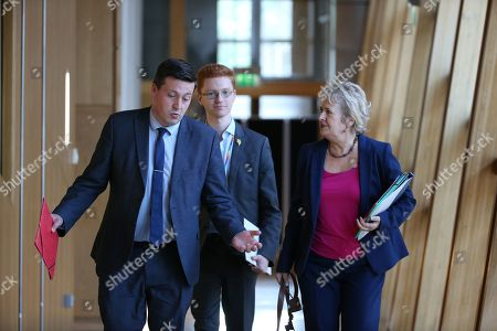 Avoiding a No-deal Exit from the EU debate at The Scottish Parliament - Jamie Hepburn, Minister for Business, Fair Work and Skills, Ross Greer, and Roseanna Cunningham, Cabinet Secretary for Environment, Climate Change and Land Reform, make their way to the Debating Chamber