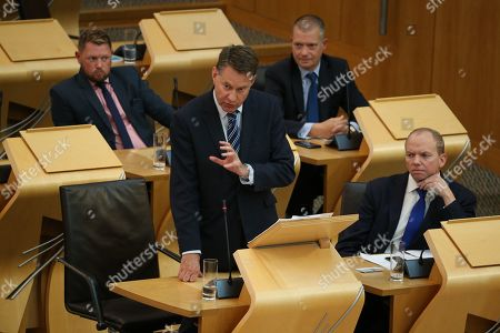 Stock Photo of Avoiding a No-deal Exit from the EU debate at The Scottish Parliament - Jamie Greene, Murdo Fraser, Liam Kerr and Donald Cameron