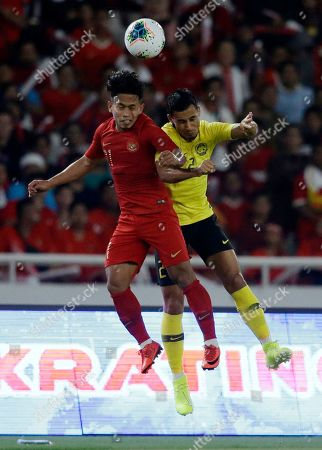 Andik Vermansah, Matthew Davies. Indonesia's Andik Vermansah, left, fights for the ball with Malaysia's Matthew Davies, left, during their World Cup Group G Asia qualifying soccer match between Indonesia and Malaysia at Gelora Bung Karno Stadium in Jakarta, Indonesia