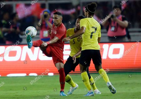 Alberto Goncalves, Adam Nor Azlin, Corbin Ong Lawrence. Indonesia's Alberto Goncalves, left, fights for the ball with Malaysia's Adam Nor Azlin, center, and Corbin Ong Lawrence, right, during their World Cup Group G Asia qualifying soccer match between Indonesia and Malaysia at Gelora Bung Karno Stadium in Jakarta, Indonesia