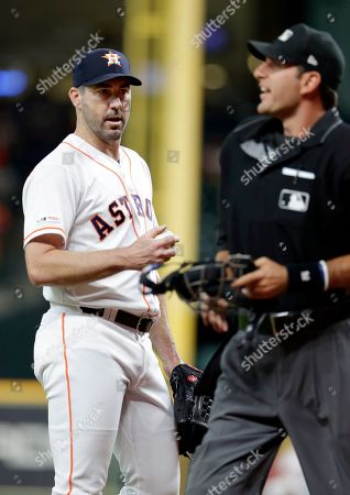 Justin Verlander, Pat Hoberg. Houston Astros starting pitcher Justin Verlander, left, listens to umpire Pat Hoberg after a walk call during a baseball game, in Houston. Hoberg ejected Verlander for arguing a balls and strikes call later in the game
