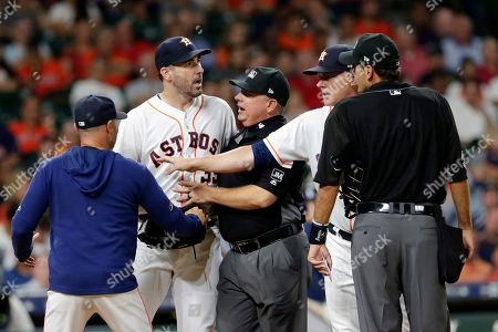 Justin Verlander, Joe Espada, Greg Gibson, A.J. Hinch, Pat Hoberg. Houston Astros starting pitcher Justin Verlander, facing, is held back by bench coach Joe Espada, left, first base umpire Greg Gibson and manager A.J. Hinch as Verlander argues with home plate umpire Pat Hoberg, right, after Hoberg ejected Verlander for arguing balls and strikes during a baseball game against the Tampa Bay Rays, in Houston