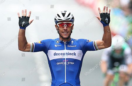 Belgian rider Philippe Gilbert of the Deceuninck-Qiuck Step team celebrates while crossing the finish line to win the 12th stage of the Vuelta a Espana cycling race over 171.4km from Circuito de Navarra to Bilbao, northern Spain, 05 September 2019.