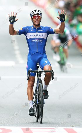 Belgian rider Philippe Gilbert of the Deceuninck-Quick Step team celebrates while crossing the finish line to win the 12th stage of the Vuelta a Espana cycling race over 171.4km from Circuito de Navarra to Bilbao, northern Spain, 05 September 2019.