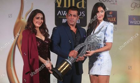 Madhuri Dixit, Salman Khan, Katrina Kaif. Bollywood actors, from left, Madhuri Dixit, Salman Khan and Katrina Kaif hold a trophy and stand for photographs during a press conference to announce the dates and venue for International Indian Film Academy (IFFA) awards 2019 in Mumbai, India, . The 20th IFFA awards ceremony will be held in Mumbai on Sept. 18