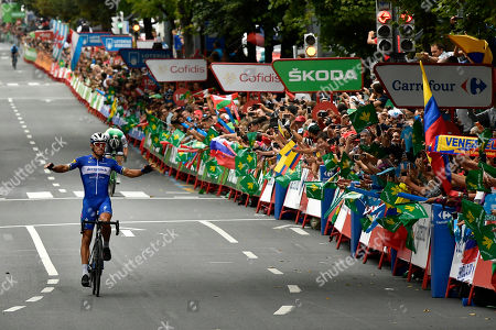 Deceunink -Quick's Team Philippe Gilbert of Belgium celebrates after winning the stage during the 12th stage between Circuito de Navarra- Los Arcos and Bilbao, 171,4 kilometers (106,50miles), of the Spanish Vuelta cycling race that finishes in Bilbao, northern Spain, Thursday, Sept.5, 2019