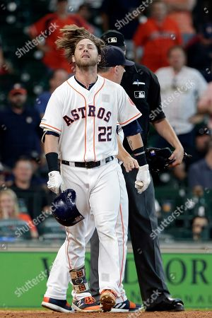 Josh Reddick, Jordan Baker, AJ Hinch. Houston Astros' Josh Reddick (22) flips his hair as he walks away after being ejected while arguing a strike call by home plate umpire Jordan Baker, back, as manager AJ Hinch, center, steps between them during a baseball game against the Tampa Bay Rays, in Houston