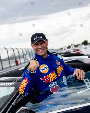 German former boxing champion Axel Schulz poses during the 'Place to B Racing for Charity' event at the Porsche Leipzig circuit in Leipzig Germany, 05 September 2019.