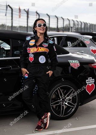 Stock Photo of Austrian actress Sonja Kirchberger poses during the 'Place to B Racing for Charity' event at the Porsche Leipzig circuit in Leipzig Germany, 05 September 2019.