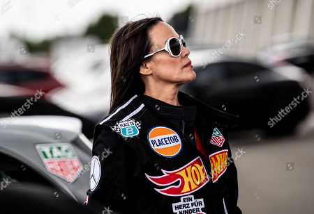 Austrian actress Sonja Kirchberger poses during the 'Place to B Racing for Charity' event at the Porsche Leipzig circuit in Leipzig Germany, 05 September 2019.