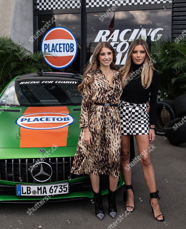 German actress and model Sophia Thomalla (R) and German TV presenter Cathy Hummels pose during the 'Place to B Racing for Charity' event at the Porsche Leipzig circuit in Leipzig Germany, 05 September 2019.