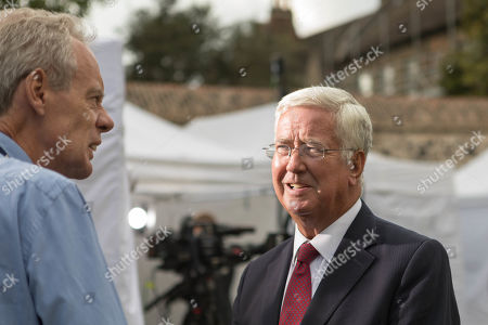 Stock Image of Sir Michael Fallon, Conservative MP, on College Green at Westminister