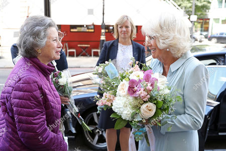 Camilla Duchess of Cornwall talks to spectators as she leaves Carisbrooke Hall and President of The Royal Osteoporosis Society