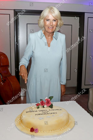 Camilla Duchess of Cornwall cutting a cake to celebrate the British Dance Councils 90th birthday at Carisbrooke Hall and President of The Royal Osteoporosis Society