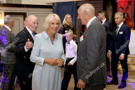 Camilla Duchess of Cornwall enters the floor to dance with Len Goodman during an event organized by the British Dance Council in association with The Royal Osteoporosis Society at Carisbrooke Hall and President of The Royal Osteoporosis Society