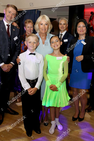 Camilla Duchess of Cornwall meets Andrey Chernov (9) and Kristyna Fatuliaj (10) during a dance performance organized by the British Dance Council in association with The Royal Osteoporosis Society at Carisbrooke Hall and President of The Royal Osteoporosis Society