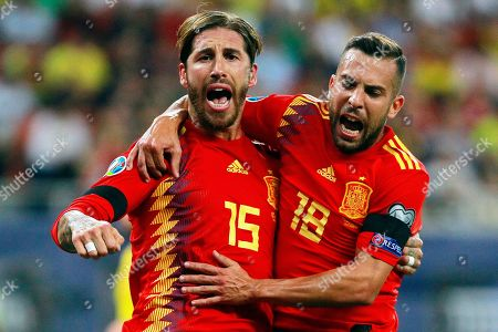 Spain's captain Sergio Ramos (L) celebrates with his teammate Jordi Alba (R) after scoring the 1-0 lead from the penalty spot during the UEFA EURO 2020 group F qualifying soccer match between Romania and Spain at National Arena stadium in Bucharest, Romania, 05 September 2019.