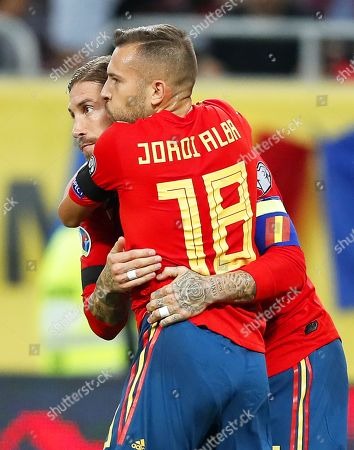 Spain's captain Sergio Ramos (back) celebrates with his teammate Jordi Alba (front) after scoring the 1-0 lead from the penalty spot during the UEFA EURO 2020 group F qualifying soccer match between Romania and Spain at National Arena stadium in Bucharest, Romania, 05 September 2019.