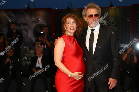 Lola Naymark, Robert Guediguian. Actress Lola Naymark and director Robert Guediguian pose for photographers upon arrival at the premiere of the film 'Gloria Mundi' at the 76th edition of the Venice Film Festival, Venice, Italy
