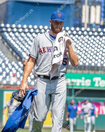 New York Mets starting pitcher Zack Wheeler (45) walks from the bullpen to the dugout prior to the game against the Washington Nationals at Nationals Park in Washington, D.C..