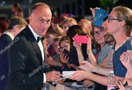 Stefano Sollima signs autographs as he arrives for the premiere of 'ZeroZeroZero' during the 76th annual Venice International Film Festival, in Venice, Italy, 05 September 2019. The series is presented out of competition at the festival running from 28 August to 07 September.