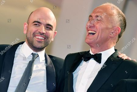 Stefano Sollima (R) and Italian author and screenwriter Roberto Saviano arrive for the premiere of 'ZeroZeroZero' during the 76th annual Venice International Film Festival, in Venice, Italy, 05 September 2019. The series is presented out of competition at the festival running from 28 August to 07 September.