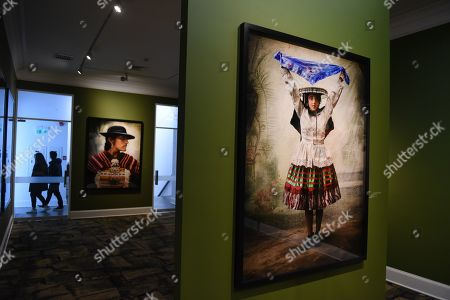 Stock Image of Portraits of villagers dressed in traditional costumes at the Mate museum during the exhibition in Lima