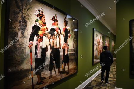 A Portrait of villagers dressed in traditional costumes at the Mate museum during the exhibition in Lima