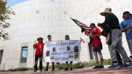Marchers pause outside the Ronald Reagan Federal Building during a 60-mile walking pilgrimage in solidarity with migrants in Santa Ana, California, USA, 05 September 2019. The Catholic group was walking to Los Angeles in preparation for a special Mass by Archibishop Jose H. Gomez honoring immigrants impacted by family separations and US government deportation policies.