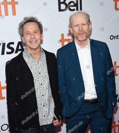 "Brian Grazer, Ron Howard. Executive producers Brian Grazer, left, and Ron Howard attend the premiere for ""Once Were Brothers: Robbie Robertson and The Band"" on day one of the Toronto International Film Festival at the Roy Thomson Hall, in Toronto"