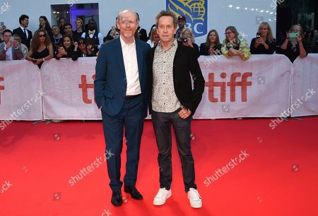 "Ron Howard, Brian Grazer. Executive producers Ron Howard, left, and Brian Grazer attend the premiere for ""Once Were Brothers: Robbie Robertson and The Band"" on day one of the Toronto International Film Festival at the Roy Thomson Hall, in Toronto"
