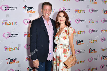 Doug Savant and Laura Leighton