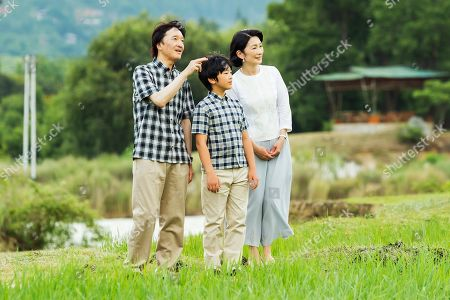 Stock Photo of In this Aug. 21, 2019, photo provided by the Imperial Household Agency of Japan, Japan's Prince Hisahito, center, with his father Crown Prince Akishino and his mother Crown Princess Kiko strolls around the paddy fields in Punakha, Bhutan. Prince Hisahito turned 13 years old on