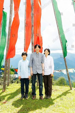 In this Aug. 18, 2019, photo provided by the Imperial Household Agency of Japan, Japan's Prince Hisahito, left, poses with his father Crown Prince Akishino and his mother Crown Princess Kiko in Bhutan. Prince Hisahito turned 13 years old on
