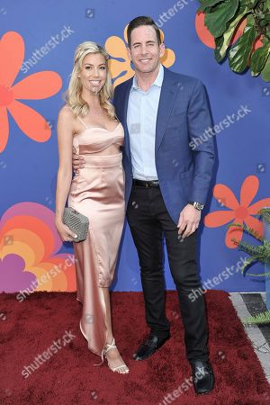 """Heather Rae Young,Tarek El Moussa. Heather Rae Young, left, and Tarek El Moussa attend the LA premiere of """"A Very Brady Renovation"""" at the The Garland Hotel, in Los Angeles"""