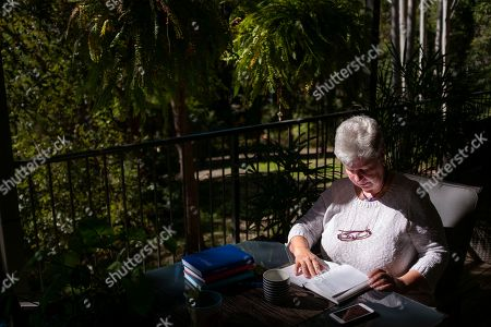 Stock Image of Deb Ware logs an entry in her diary at her home in Fountaindale, Central Coast, Australia, . Deb has chronicled the swiftness of her son's downfall in her diary, her fury and fear catalogued alongside all the drugs, the hospitalizations and the broken promises