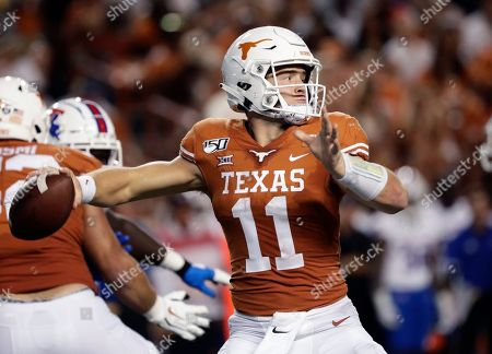 Stock Picture of Texas quarterback Sam Ehlinger (11) throws against Louisiana Tech during the second half of an NCAA college football game in Austin, Texas. For Texas, everything starts with Ehlinger, a dual-threat quarterback who is drawing comparisons to former Florida Heisman Trophy winner Tim Tebow