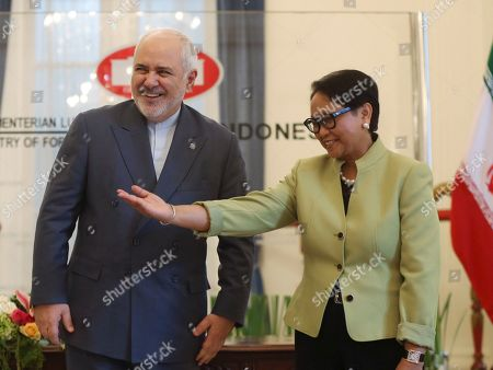 Mohammad Javad Zarif, Retno Marsudi. Iran's Foreign Minister Mohammad Javad Zarif, left, is greeted by his Indonesian counterpart Retno Marsudi prior to their meeting in Jakarta, Indonesia