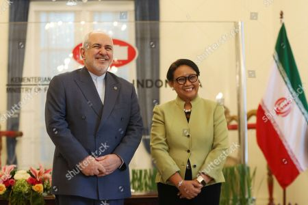 Mohammad Javad Zarif, Retno Marsudi. Iran's Foreign Minister Mohammad Javad Zarif, left, and his Indonesian counterpart Retno Marsudi pose for photographers prior to their meeting in Jakarta, Indonesia
