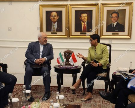 Mohammad Javad Zarif, Retno Marsudi. Iran's Foreign Minister Mohammad Javad Zarif, left, talks to his Indonesian counterpart Retno Marsudi during their meeting in Jakarta, Indonesia