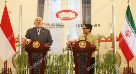 Mohammad Javad Zarif, Retno Marsudi. Iran's Foreign Minister Mohammad Javad Zarif, left, talks to journalist during a joint press conference with his Indonesian counterpart Retno Marsudi, right, after their meeting in Jakarta, Indonesia