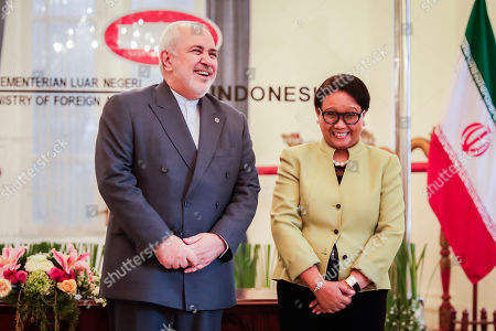 Iran's Foreign Minister Mohammad Javad Zarif (L) and his Indonesian counterpart Retno Marsudi (R) converse during their meeting in Jakarta, Indonesia, 06 September 2019. Zarif is on a visit to Indonesia to strengthen the bilateral relationship between the two countries.
