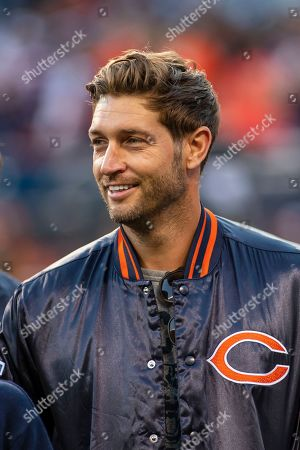 Stock Picture of Chicago, Illinois, U.S. - Former Bears Quarterback Jay Cutler visits the sidelines before the NFL Game between the Green Bay Packers and Chicago Bears at Soldier Field in Chicago, IL. Photographer: Mike Wulf