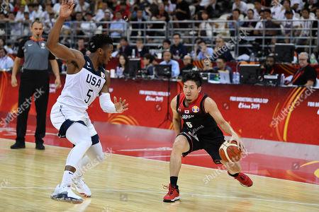 (L-R) Donovan Mitchell (USA), Makoto Hiejima (JPN) - Group E match between United States 98-45 Japan at Shanghai Oriental Sports Center