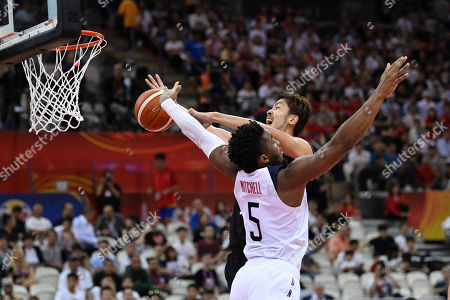 (L-R) Donovan Mitchell (USA), Kosuke Takeuchi (JPN) - Group E match between United States - Japan at Shanghai Oriental Sports Center